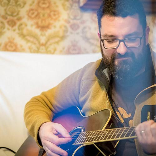 Oración con guitarra
